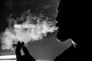 man-holding-cigarette-2389130
